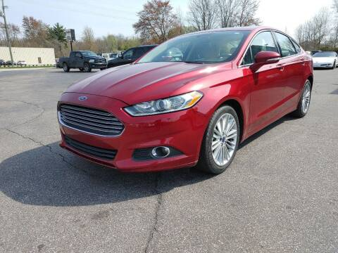 2014 Ford Fusion Hybrid for sale at Cruisin' Auto Sales in Madison IN