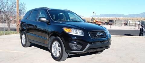 2012 Hyundai Santa Fe for sale at AUTOMOTIVE SOLUTIONS in Salt Lake City UT
