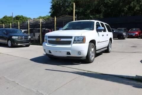 2012 Chevrolet Suburban for sale at F & M AUTO SALES in Detroit MI