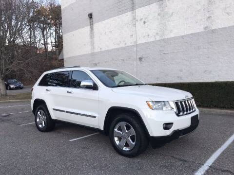 2012 Jeep Grand Cherokee for sale at Select Auto in Smithtown NY