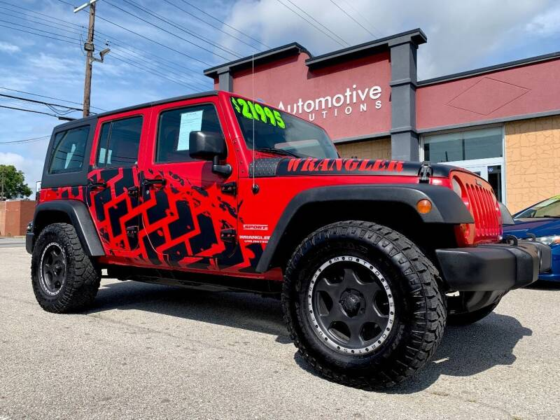 2011 Jeep Wrangler Unlimited for sale at Automotive Solutions in Louisville KY