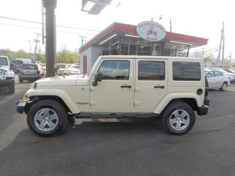2011 Jeep Wrangler Unlimited for sale at The Carriage Company in Lancaster OH