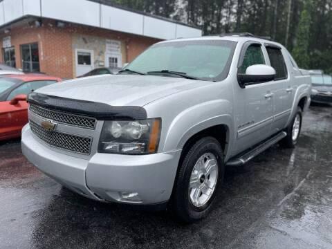 2011 Chevrolet Avalanche for sale at Magic Motors Inc. in Snellville GA