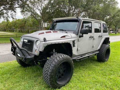 2015 Jeep Wrangler Unlimited for sale at BIG BOY DIESELS in Fort Lauderdale FL
