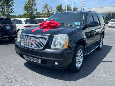 2012 GMC Yukon for sale at Charlotte Auto Group, Inc in Monroe NC