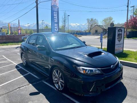 2012 Subaru Impreza for sale at The Car-Mart in Murray UT
