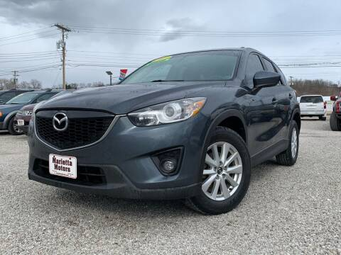 2013 Mazda CX-5 for sale at MARIETTA MOTORS LLC in Marietta OH