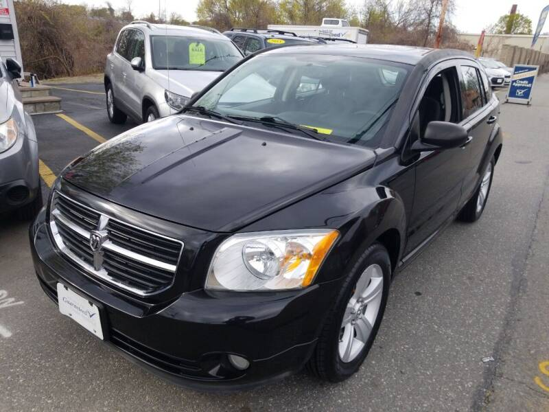 2011 Dodge Caliber for sale at Howe's Auto Sales in Lowell MA