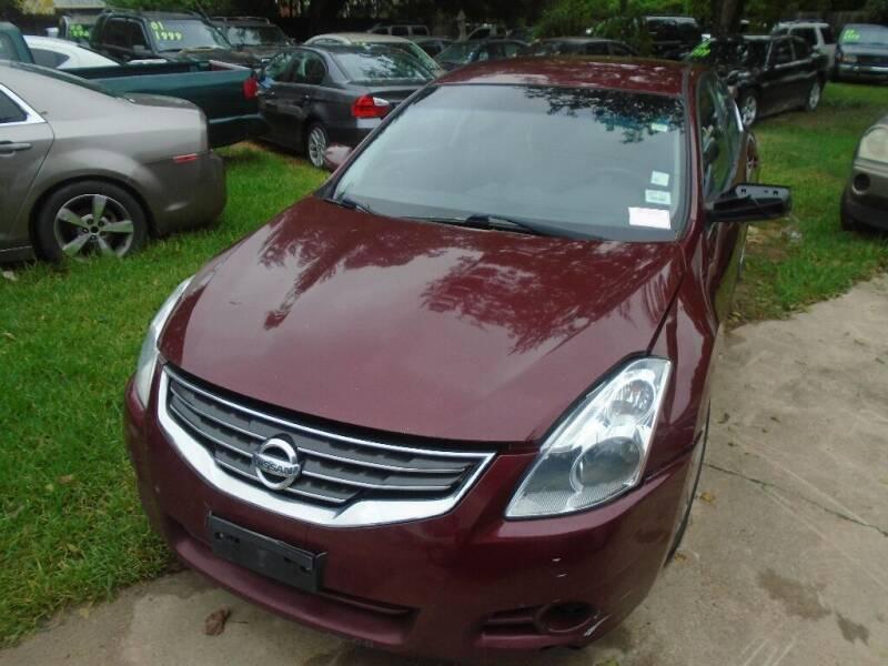 2012 Nissan Altima for sale at SCOTT HARRISON MOTOR CO in Houston TX