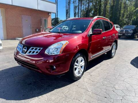 2013 Nissan Rogue for sale at Magic Motors Inc. in Snellville GA