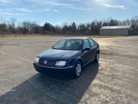 2005 Volkswagen Jetta for sale at Caruzin Motors in Flint MI