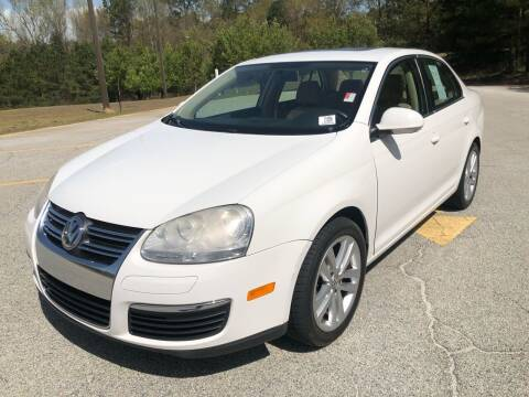 2009 Volkswagen Jetta for sale at WIGGLES AUTO SALES INC in Mableton GA