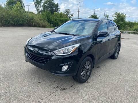 2015 Hyundai Tucson for sale at Mr. Auto in Hamilton OH