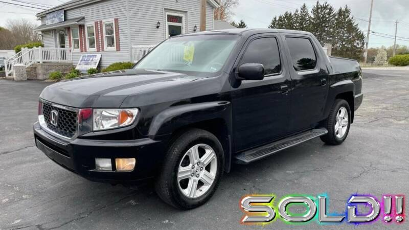 2011 Honda Ridgeline for sale at RBT Automotive LLC in Perry OH