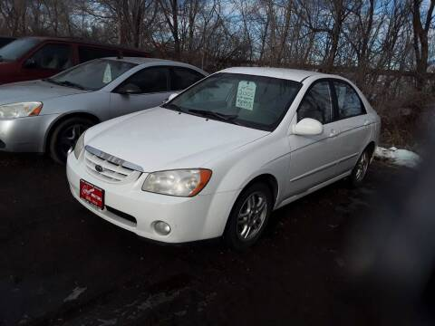 2005 Kia Spectra for sale at BARNES AUTO SALES in Mandan ND