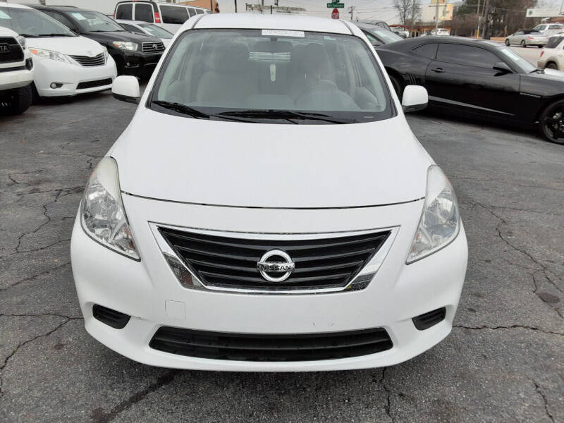 2014 Nissan Versa for sale at LOS PAISANOS AUTO & TRUCK SALES LLC in Peachtree Corners GA