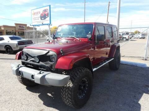 2013 Jeep Wrangler Unlimited for sale at AUGE'S SALES AND SERVICE in Belen NM