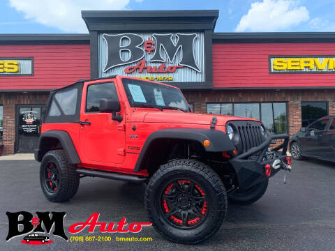 2013 Jeep Wrangler for sale at B & M Auto Sales Inc. in Oak Forest IL