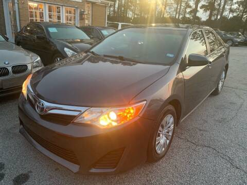 2012 Toyota Camry for sale at Philip Motors Inc in Snellville GA