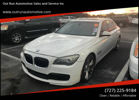 2011 BMW 7 Series for sale at Out Run Automotive Sales and Service Inc in Tampa FL