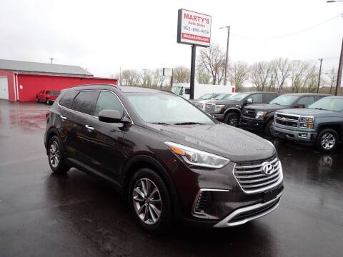 2017 Hyundai Santa Fe for sale at Marty's Auto Sales in Savage MN