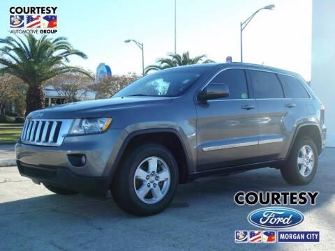 2013 Jeep Grand Cherokee for sale at Courtesy Toyota & Ford in Morgan City LA