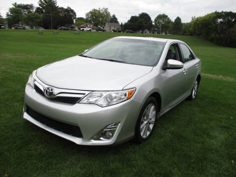 2012 Toyota Camry for sale at Triangle Auto Sales in Elgin IL