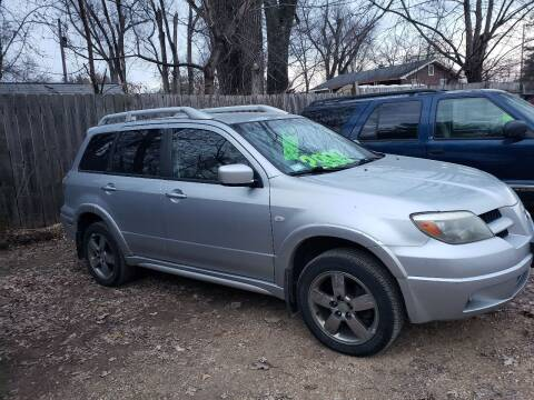 2006 Mitsubishi Outlander for sale at Northwoods Auto & Truck Sales in Machesney Park IL