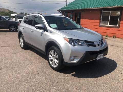 2015 Toyota RAV4 for sale at BERKENKOTTER MOTORS in Brighton CO