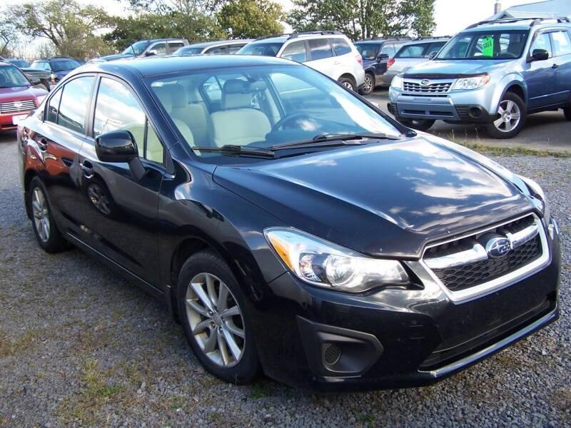 2012 Subaru Impreza for sale at B & J Auto Sales in Tunnelton WV