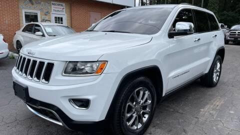 2014 Jeep Grand Cherokee for sale at Magic Motors Inc. in Snellville GA