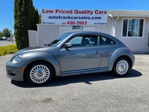 2013 Volkswagen Beetle for sale at AUTOTRACK INC in Mount Vernon WA