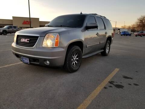 2009 GMC Yukon for sale at KHAN'S AUTO LLC in Worland WY