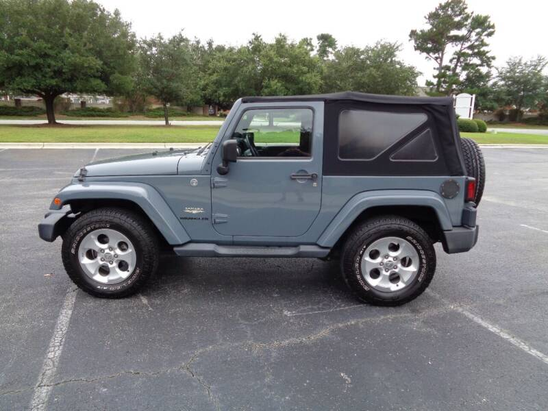 2015 Jeep Wrangler for sale at BALKCUM AUTO INC in Wilmington NC