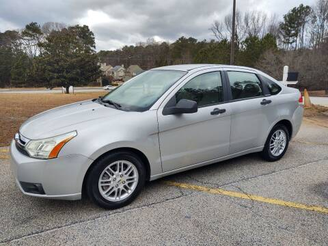 2009 Ford Focus for sale at WIGGLES AUTO SALES INC in Mableton GA