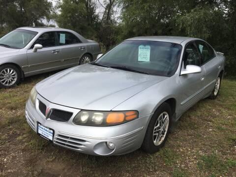 2000 Pontiac Bonneville for sale at BARNES AUTO SALES in Mandan ND