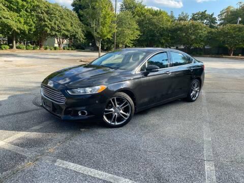 2013 Ford Fusion for sale at Uniworld Auto Sales LLC. in Greensboro NC