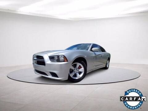 2012 Dodge Charger for sale at Carma Auto Group in Duluth GA