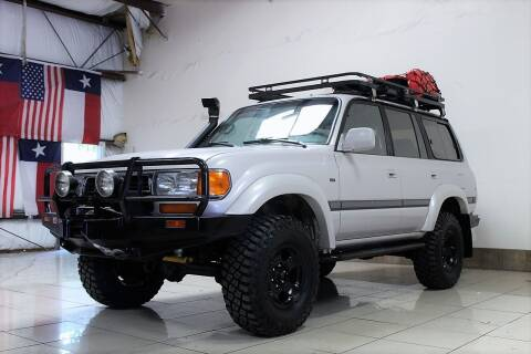 1997 Toyota Land Cruiser for sale at ROADSTERS AUTO in Houston TX