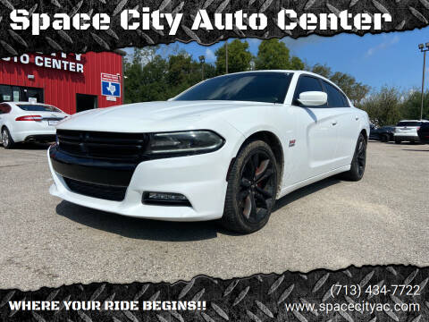 2015 Dodge Charger for sale at Space City Auto Center in Houston TX
