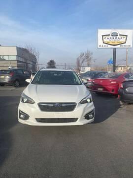 2017 Subaru Impreza for sale at CarSmart Auto Group in Murray UT