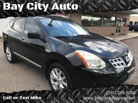2013 Nissan Rogue for sale at Bay City Auto's in Mobile AL