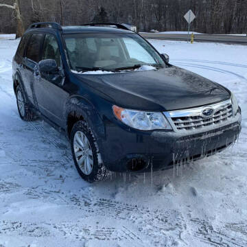 2011 Subaru Forester for sale at American & Import Automotive in Cheektowaga NY