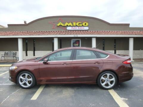 2015 Ford Fusion for sale at AMIGO AUTO SALES in Kingsville TX