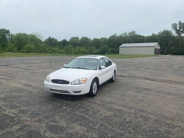 2006 Ford Taurus for sale at Caruzin Motors in Flint MI