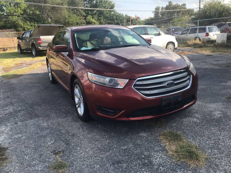 2014 Ford Taurus for sale at K-M-P Auto Group in San Antonio TX