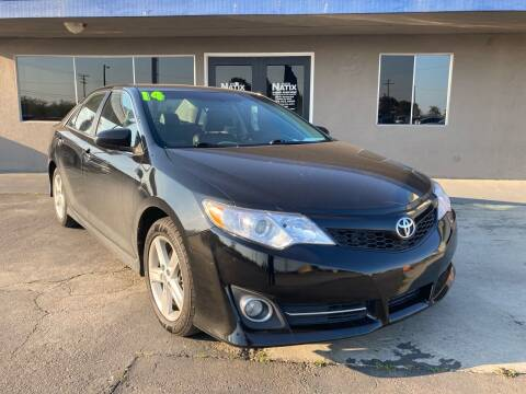 2014 Toyota Camry for sale at AUTO NATIX in Tulare CA