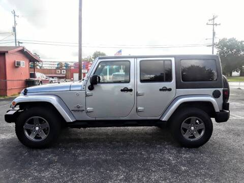 2013 Jeep Wrangler Unlimited for sale at Rons Auto Sales in Stockdale TX