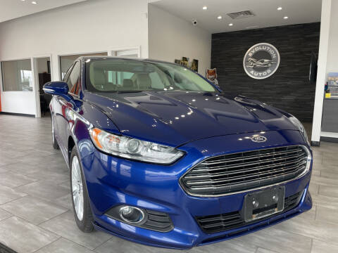 2013 Ford Fusion Hybrid for sale at Evolution Autos in Whiteland IN