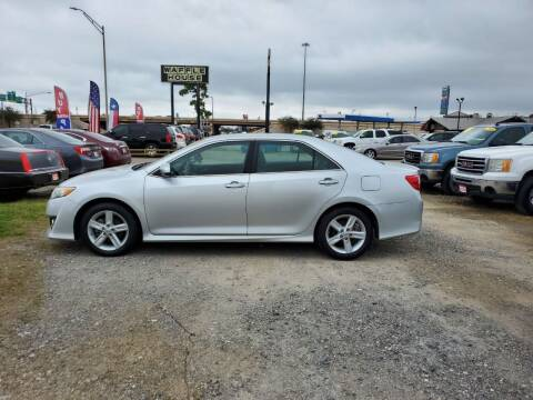 2014 Toyota Camry for sale at Taylor Trading Co in Beaumont TX